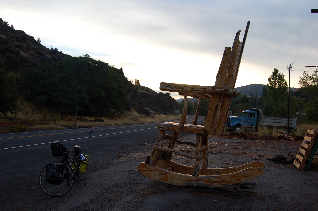 Giant wooden rocking chair. - bicycle for scale