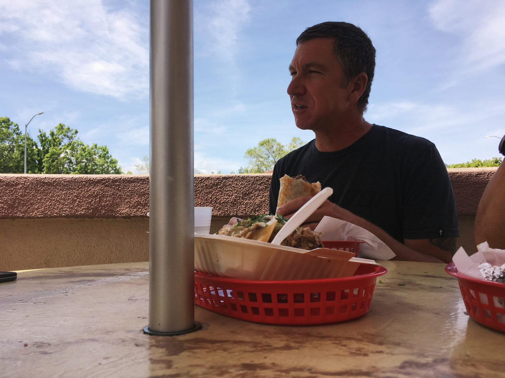 Robert Egger at Super Taqueria, during a planning meeting. He could not attend due to having to be a Mom to a premature goat. Seriously.
